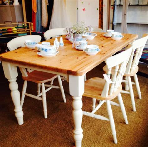 dining room  pine table  painted chairs