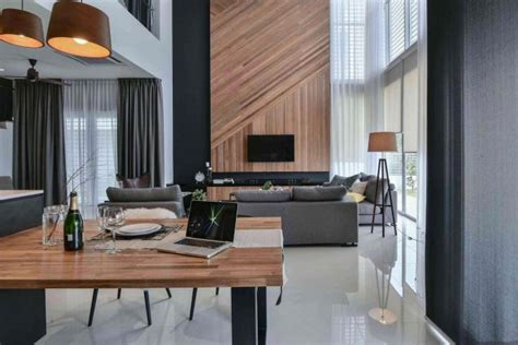 Wil's 11 Residence: living room with a double volume wood