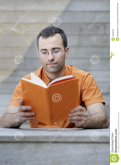 young handsome adult reading  book royalty  stock