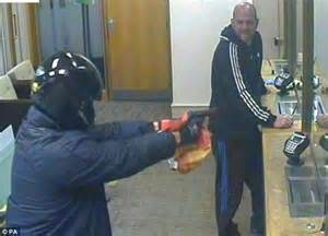 Robber jailed for life for trying to hold up a bank with ...