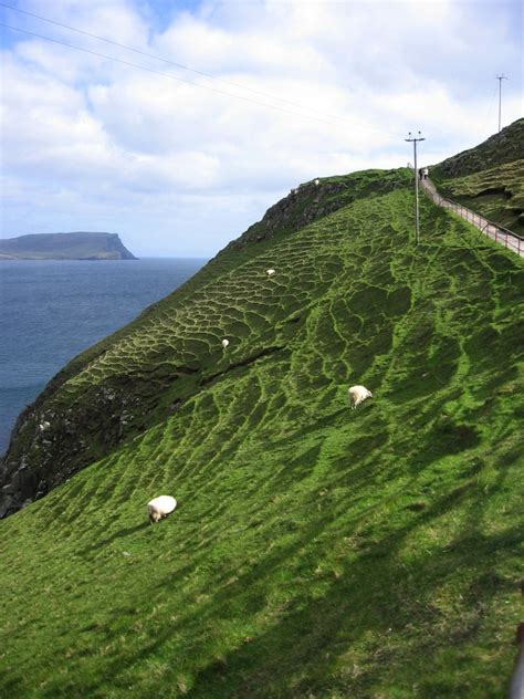 Walking To Neist Point Lighthouse On The Isle Of Skye