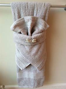 Fancy towel folding with dragonfly bling pinteres for Bathroom towel decorative folds