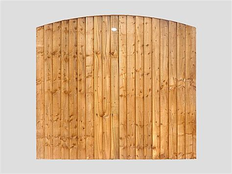 traditional garden fence panels curved feather edge vertical tanalized brown panels pennine