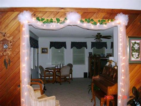 white lights tulle ivy   doorway tulle bows
