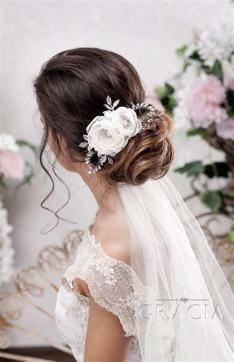 enhance your bridal hair half up half down hairstyle with veil accessory wedding