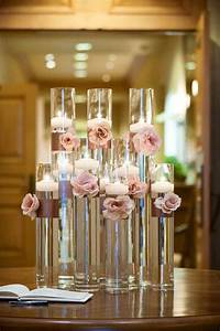 Floating candle and flower centerpiece make for a simple ...