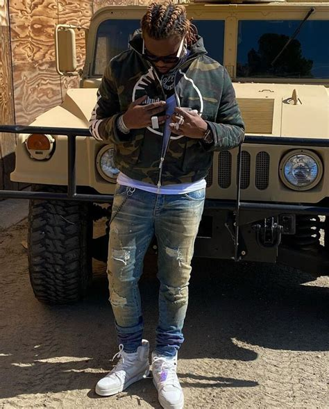 gunna  military hummer  rhude camo jacket louis vuitton sneakers incorporated style