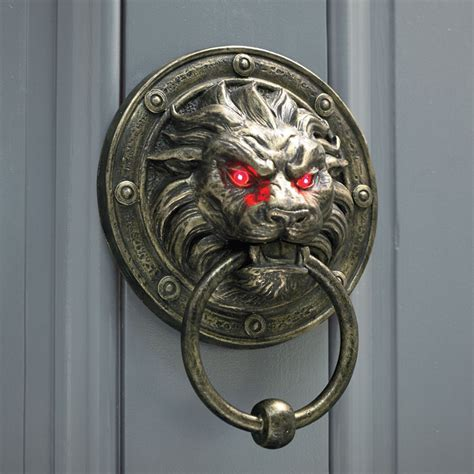 creepy lion door knocker  glowing eyes  green head