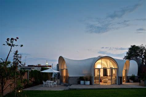 Six Parabolic Modules Shape Up Original House Design in