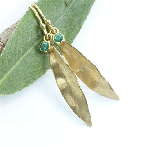 gold leaf design emerald earrings in 18ct gold leaf design by lilia nash