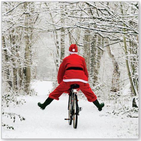 santa claus riding a bike cycling passion