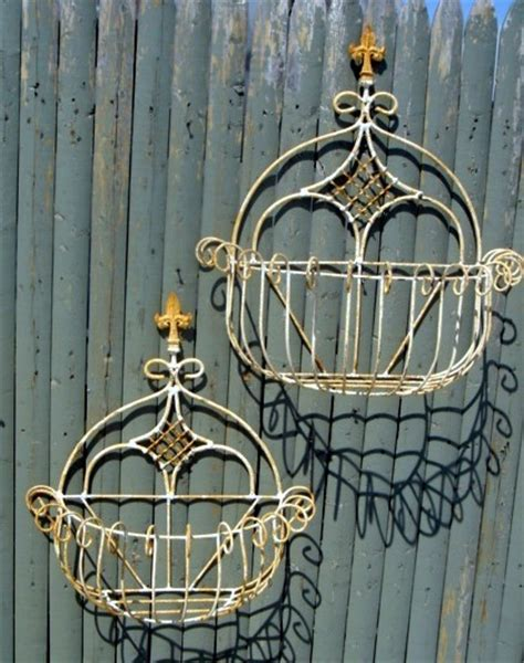 outdoor wall planters wrought iron wrought iron curl spear baskets in 2 sizes