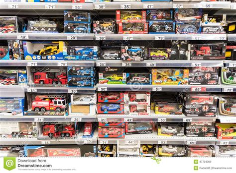 car toys  small children  supermarket stand editorial