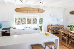 Mid Century Modern Dining Room Light Fixture by Serene Beach House Taken Over By Coastal Beauty