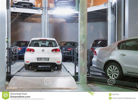 The Volkswagen Golf On Lift In Tower For Store Cars