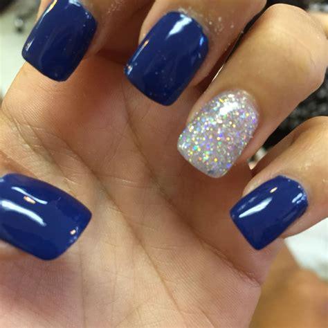 royal blue acrylic nails  silver hair makeup
