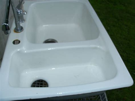pre owned white porcelain  cast iron double basin