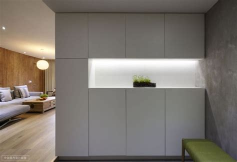 Shanghai Apartment With Modern Minimalist Flair by Simple Storage With Well Lit Niche Containing Modest Plant
