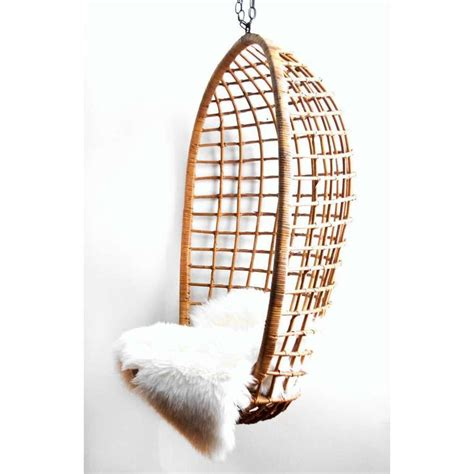 vintage hanging rattan egg chair lobby