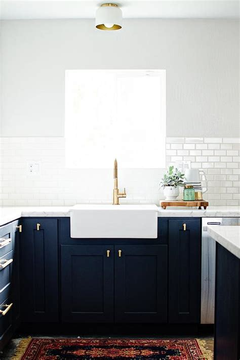 navy shaker kitchen cabinets  brushed brass knobs