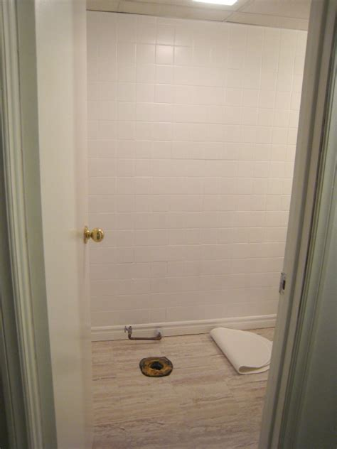 remodelaholic   bathroom makeover  painted tile