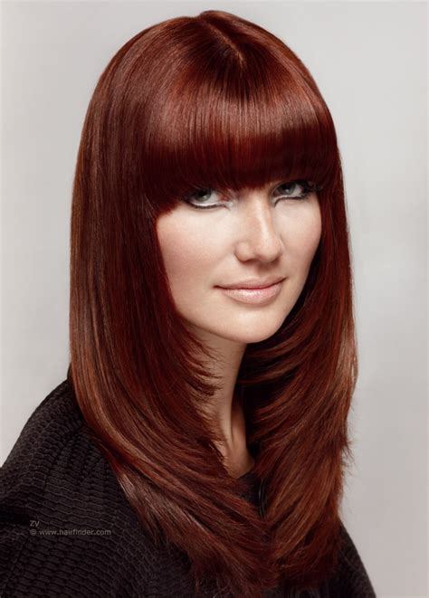 sleek long hairstyle with tapered and layered sides