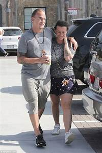 Alanis Morissette shows off tiger tattoo with husband ...