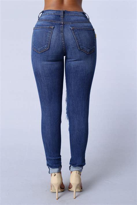 light blue cut up jeans beach bum jeans medium blue