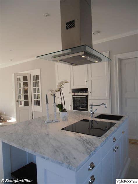 islands in a kitchen spisfläkt marmorskiva kök inredning borga