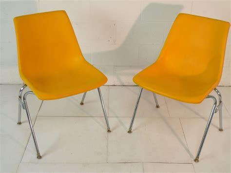 yellow plastic mid century modern eames era  chair