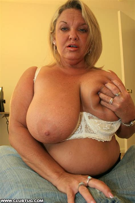 Fatty mature lady with huge jugs sucking and jerking a big ...