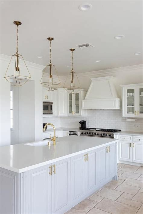 gold lanterns hang   light gray island accented