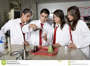 High School Students Conducting Science Experiment Stock ...
