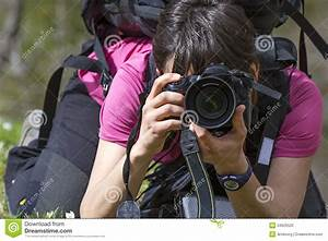Young Woman Photographer In Action Stock Photo