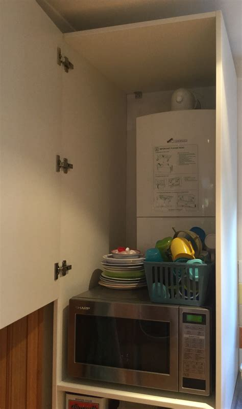 boilerkitchen cupboard  easy access  pipes diy