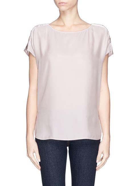 silk charmeuse blouse vince button shoulder silk charmeuse blouse in purple lyst