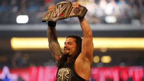 roman reigns real  age family tattoos theme song