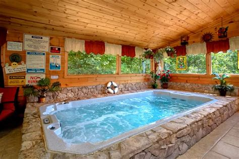 private bath pool heated log cabin with luxury splashing bedroom pin indoor sunrise pools cabins