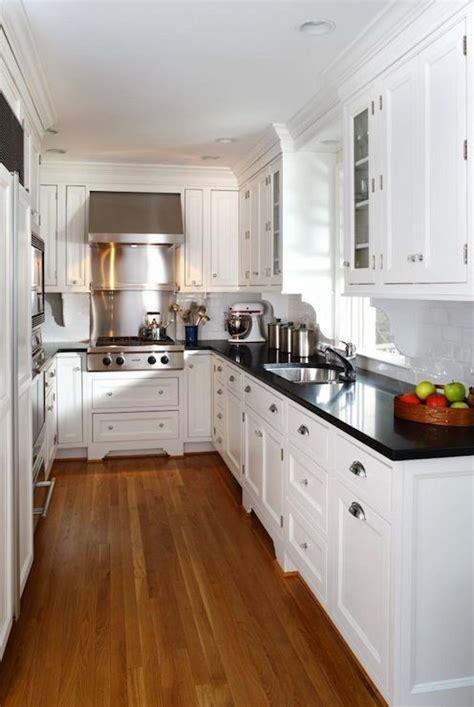 white kitchen cabinets with black granite sallyl ahmann llc absolute black granite countertops 2063