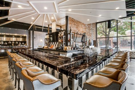 barre cuisine zebrino black and gold bar at stirr restaurant by coeval