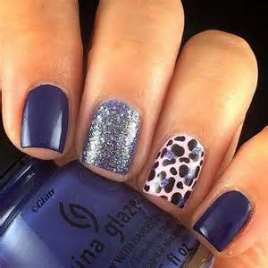 Pretty looking dark blue nail art design the nails have a of