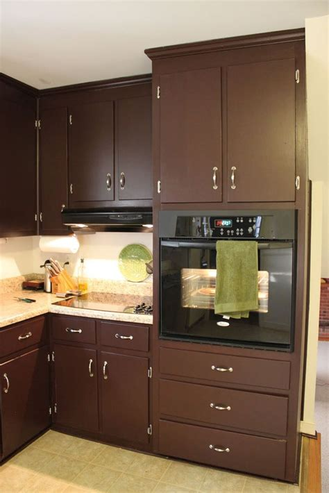 brown painted kitchen cabinets silver hardware