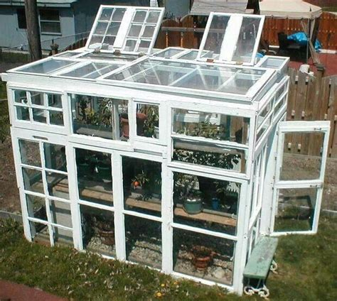 The purpose of greenhouse is protect your seedlings and growing plants from cold and critters. Old windows green house | ANY DIY | Pinterest
