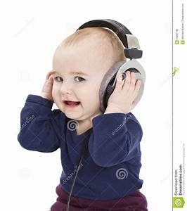 Young Child With Ear-phones Listening To Music Stock Photo ...