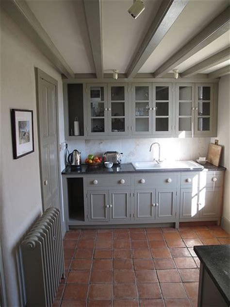 terracotta floor tiles kitchen grey cupboards and terracotta tiles try farrow and 6032