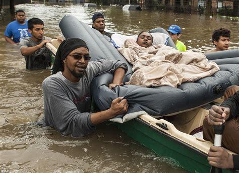houston flooding sees  dead   month  rain fell