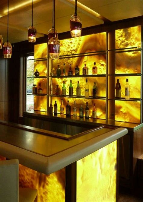 continuous backsplashes  onyx slabs  countertops bar remodel wall bar home bar