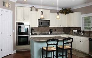 Black Countertops White Cabinets Blue Walls Kitchen With