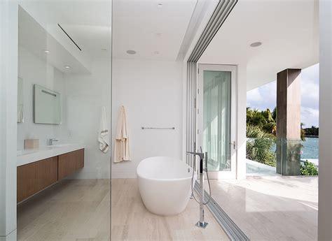 dramatic miami residence offers luxury draped  coastal