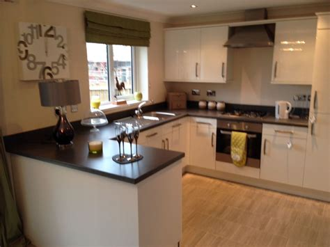 kitchen cabinets with island kitchen in show home persimmon seaton vale kitchen 6473